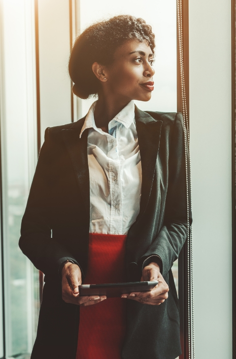 Woman Leader Looking Out Window Image