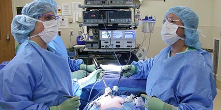 Two periop nurses at the operating table